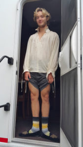 Toby Regbo wearing the socks Marilla Wex knitted him as a leaving present